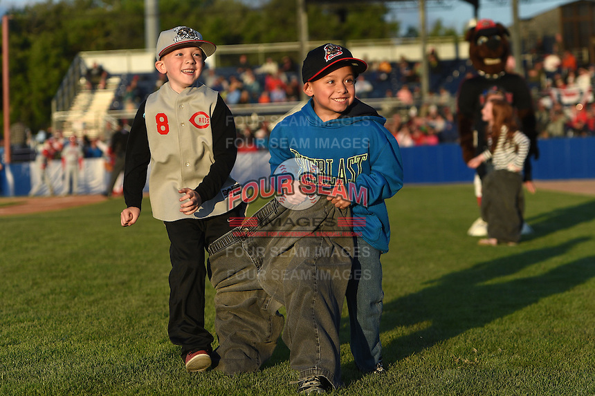 Batavia Muckdogs young fans during an on field promotion in between innings during a game against the Auburn Doubledays on June 14, 2014 at Dwyer Stadium in Batavia, New York.  Batavia defeated Auburn 7-2.  (Mike Janes/Four Seam Images)