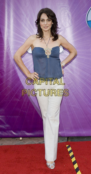 ANNIE PARISSE.Network All Star Celebration held at the Century Club, .Los Angeles, 25th July 2005.full length full-length white trousers blue chiffon halterneck top diamante hand hip silver sandals shoes.www.capitalpictures.com.sales@capitalpictures.com.© Capital Pictures.