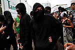 Members of the Black Bloc anarchist group and other protesters march through the streets during the 2012 Republican National Convention on August 27, 2012 in Tampa, Fla.