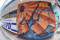 Mosaic map (western wall) of New York by the artist Edward Meshekoff adorns the exterior wall of the NYPD substation in Times Square in New York seen on Thursday, March 10, 2016. With the renovation in store for the substation the city is pondering where and how to preserve the mosaics. Prior to its life as a substation the small building was the Times Square Information Center opened in 1957 with the police taking residency in 1993. (© Richard B. Levine)