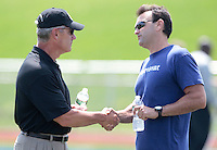 HEMPFIELD TOWNSHIP, PA - AUGUST 20:  Agent Drew Rosenahus shakes hands with former Ohio State football head coach Jim Tressel following Terrelle Pryor's pro day at a practice facility on August 20, 2011 in Hempfield Township, Pennsylvania.  (Photo by Jared Wickerham/Getty Images)