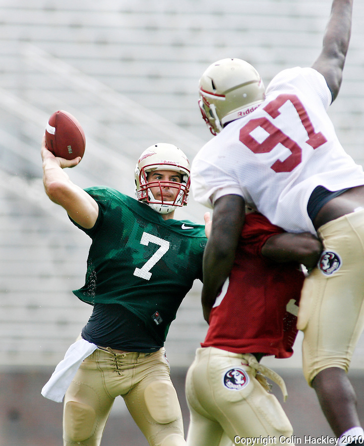 TALLAHASSEE, FL 8/21/10-FSU-082110 CH-Florida State's Christian Ponder gets a pass around a flying Demonte McAllister during scrimmage Saturday in Tallahassee. .COLIN HACKLEY PHOTO