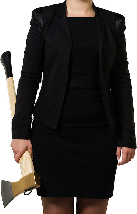 businesswoman ready to put an axe to work and chop to make the business healthy