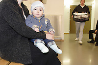 A Chechen refugee mother with here baby in the waiting room in the Vallorbe registration Centre of the Swiss Federal Office for Refugees (CERA)..There lifes was in permanent threat in Chechnya..They reaches Switzerland 2 week ago hide in the back of a lorry. .The newly born boy is under medical treatment for having be oblige by the human smugglers, to take over dose of sedative during the hided and silenced journey to reaches Switzerland..They are now on procedure of registration, hoping to be accepted. .The CERA of Vallorbe have a capacity of 200 bed and cover. A inside and outside kindergarten, a library within different religious book but a shortage of Koran, a daily visiting cleric, a inside open courtyard for football, 2 dining room who are also Tv and gaming room, 3 copious and equilibrate meal per day are offer to the refugees, an 20 Securitas (private security company) working on 24h a day shift. .High wire netting with barbed wire on the top and video surveillance are all over the building, but all the door of the building are 24h open to exit say the head Securitas.