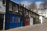 Mews housing London. Cromwell Mews London SW7 UK.  National History Museum in distance.