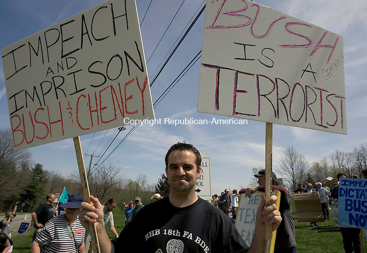 KENT, CT-25 APRIL 2008 --042508JS07-Cory Soulier of Torrington, a United States Army veteran, was one of the one-hundred protesters to gather on Route 341 near the Warren Congregational Church on Friday to protest the visit of President George W. Bush to the home of former U.S. Secretary of State Henry Kissinger in Kent. President Bush was visiting as part of a fund-raiser lunch for congressional candidate David J. Cappiello (R-Danbury).<br /> Jim Shannon / Republican-American