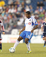 Montreal Impact midfielder Patrice Bernier (8) controls the ball. In a Major League Soccer (MLS) match, Montreal Impact (white/blue) defeated the New England Revolution (dark blue), 4-2, at Gillette Stadium on September 8, 2013.