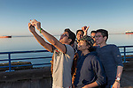 A group of Indonesian foreign students, going to college in Port Angeles, pose for a group selfie on the P.A. pier.