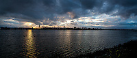 Panoramic image of storm clouds hovering over San Leandro Bay at the MLK Regional Shoreline directly east of the Oakland International Airport.  Winter in the Bay Area.