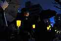 Tokyo, Japan - March 11: People held candles in front of the Diet Building at Chiyoda, Tokyo, Japan as a demonstration against nuclear power on March 11, 2012. More than 10,000 people held the candles and hands of next people to make a &quot;Human Chain.&quot; As this day was one year anniversary of Great East Japan Earthquake and Tsunami, there were many demonstrations held in the city.