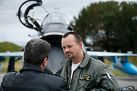 Norwegian F-16 pilot Maj Dragsnes talks to MiG-21 F pilot Capt Alexandru Catalin of the 95th Air Force Base from the Romanian Air Force. BOLD AVENGER 2007 (BAR 07), a NATO  air exercise at Ørland Main Air Station, Norway. BAR 07 involved air forces from 13 NATO member nations: Belgium, Canada, the Czech Republic, France, Germany, Greece, Norway, Poland, Romania, Spain, Turkey, the United Kingdom and the United States of America. The exercise was designed to provide training for units in tactical air operations, involving over 100 aircraft, including combat, tanker and airborne early warning aircraft and about 1,450 personnel.
