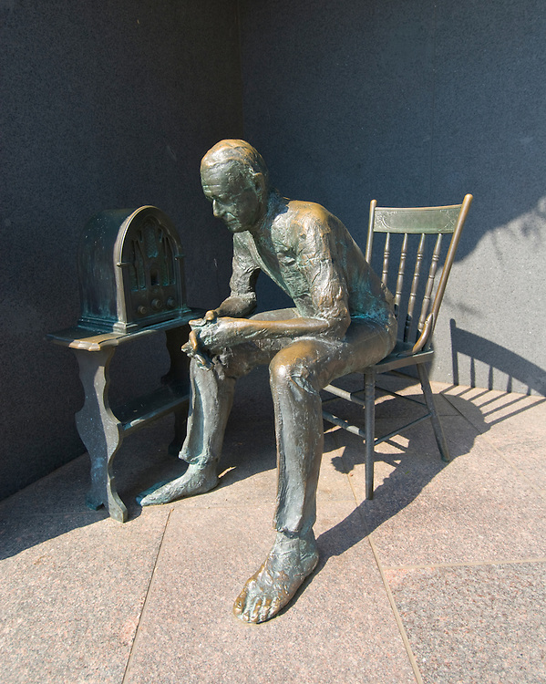 Washington DC; USA: The Franklin Delano Roosevelt Memorial. Sculpture of a citizen listening to a Fireside Chat on the radio.  .Photo copyright Lee Foster Photo # 14-washdc83254