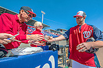 5 March 2013: Washington Nationals outfielder Bryce Harper autographs a crystal baseball prior to a Spring Training game against the Houston Astros at Space Coast Stadium in Viera, Florida. The Nationals defeated the Astros 7-1 in Grapefruit League play. Mandatory Credit: Ed Wolfstein Photo *** RAW (NEF) Image File Available ***