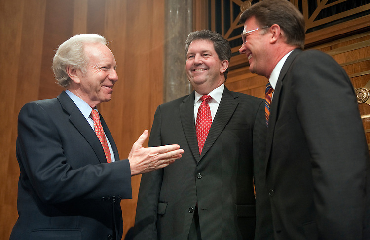 "UNITED STATES - SEPTEMBER 06:  Chairman Joe Lieberman, I-Conn., left, talks with Patrick Donahoe, center, Postmaster General, and John Berry, director of the United States Office of Personnel Management before a Senate Homeland Security and Governmental Affairs Committee hearing entitled ""U.S. Postal Service in Crisis: Proposals to Prevent a Shutdown."" (Photo By Tom Williams/Roll Call)"