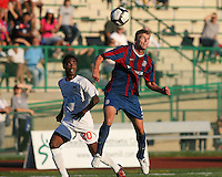 Andrew Marshall #5 of Crystal Palace Baltimore heads the ball away from Gregory Richardson #20 of the Carolina Railhawks during an NASL match at Paul Angelo Russo Stadium in Towson, Maryland on September 18 2010. Carolina won 4-2.