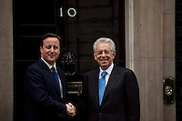 David Cameron (British Prime Minister) and Mario Monti (Italian Prime Minister) - 2012<br /> <br /> London, 18/01/2012. Mario Monti had his first institutional visit of the UK today, as the new Italian Prime Minister. &quot;Il Professore&quot; arrived at Downing Street at 13:00, where his host David Cameron was waiting, along with a number of prominent Italian and British members of the press. However a series of protocol mishaps ensued. After a friendly first handshake as Mario Monti leaves his car, the British and Italian Prime Ministers take their position at the door of No.10 for the press photo opportunity.  It becomes apparent that no aide has been arranged by Downing Street to take Monti's coat, leaving the Italian Prime Minister fidgeting for an embarrassing while, as Cameron remains frozen, holding out an awkward un-met hand. Later, the famous &quot;UK First Cat&quot; was spotted, waiting outside his house for staff to open the door. Around 14:30, the meeting was seen to end as unconventionally as it had started: Mario Monti walked out of the door of the residence of the British Prime Minister with some of his staff, but without assistance or public send-off by Cameron.