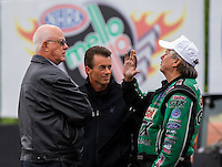 May 18, 2014; Commerce, GA, USA; NHRA funny car driver John Force (right) and top fuel driver Clay Millican (center) talks with NHRA official Graham Light during the Southern Nationals at Atlanta Dragway. Mandatory Credit: Mark J. Rebilas-USA TODAY Sports