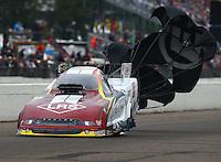 Aug 17, 2014; Brainerd, MN, USA; NHRA funny car driver Tim Wilkerson during the Lucas Oil Nationals at Brainerd International Raceway. Mandatory Credit: Mark J. Rebilas-