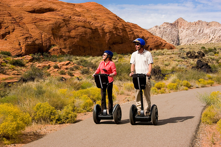 Couple on a Segway at Snow Canyon State Park, Utah, UT, scenic, landscape, Segways, Segway riders, model released, rock formations, landforms, Navajo sandstone, arid, Southwest America, American Southwest, US, United States, Image ut415-18820, Photo copyright: Lee Foster, www.fostertravel.com, lee@fostertravel.com, 510-549-2202