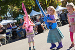 Jasmine Guymon, Colby J. and Maddie Guymon, take up guitars to rock out to music at the Los Altos Fall Festival.