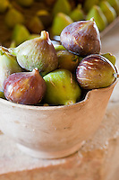 Detail of a bowl of ripe figs