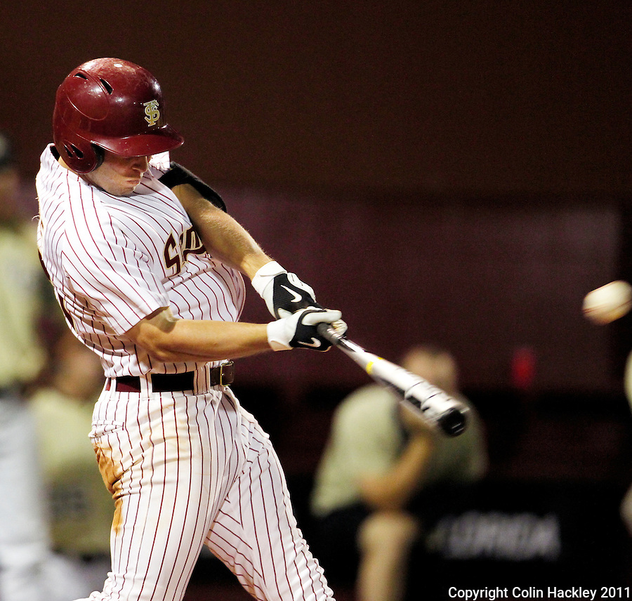 TALLAHASSEE, FL 5/7/11-FSU-UCFBASE11 CH-Florida State's Mike McGee connects for a grand slam home run in the seventh inning against the University of Central Florida Saturday at Dick Howser Stadium in Tallahassee. The Seminoles lost to the Knights 10-14..COLIN HACKLEY PHOTO