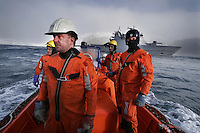 Coastguard inspectors board russian freight ship Murminsk while she is loading fish from fishing trawler Topaz A, just off Bjørnøya. Coastguard vessel KV Svalbard patrols the northermost waters of Norway, including around the islands that she is named after. The main task is inspecting fishing boats, but she also performs search and rescue missions, and environmental monitoring.