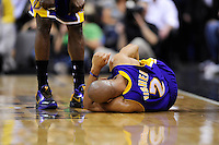The Lakers' Derek Fisher reacts in pain after a collision. Los Angeles defeated Washington 115-103 at the Verizon Center in Washington, DC on Tuesday, January 26, 2010.  Alan P. Santos/DC Sports Box