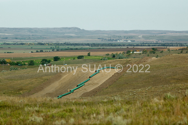 near St. Anthony, North Dakota<br /> September 26, 2016<br /> <br /> The Dakota Access Pipeline under construction, will transport light, sweet crude oil from the North Dakota Bakken region through South Dakota and Iowa into Illinois.<br /> <br /> The Standing Rock Sioux, whose tribal lands are a half-mile south of the proposed route, say the pipeline would desecrate sacred burial and prayer sites, and could leak oil into the Missouri and Cannon Ball rivers, on which the tribe relies for water.<br /> <br /> Opposition to the pipeline has drawn support from 200 Native American tribes, as well as from activists and celebrities. <br /> <br /> Energy Transfer Partners&mdash;one of the major stakeholders in the controversial Dakota Access pipeline&mdash;bought over 6,000 acres of land surrounding the line&rsquo;s route in North Dakota, according to several media reports over the weekend.