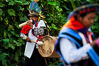"""A native from the Kamentsá tribe, wearing a colorful feather headgear, plays drum during the Carnival of Forgiveness, a traditional indigenous celebration in Sibundoy, Colombia, 12 February 2013. Clestrinye (""""Carnaval del Perdón"""") is a ritual ceremony kept for centuries in the Valley of Sibundoy in Putumayo (the Amazonian department of Colombia), a home to two closely allied indigenous groups, the Inga and Kamentsá. Although the festival has indigenous origins, the Catholic religion elements have been introduced and merged with the shamanistic tradition. Celebrating annually the collaboration, peace and unity between tribes, they believe that anyone who offended anyone may ask for forgiveness this day and all of them should grant pardons."""