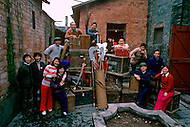 April 15th, 1989, Poyang, Jiangxi Province, China. Traveling opera troupe preparing to move to the next village for another performance. All members collaborate for transporting the troupe's equipment.