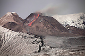 Nighttime view of incandescent rockfall of glowing lava down flank of lava dome of Shiveluch Volcano, Kamchatka, Russia.