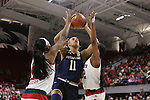 29 December 2016: Notre Dame's Brianna Turner (11) is defended by NC State's DD Rogers (left) and Akela Maize (right). The North Carolina State University Wolfpack hosted the University of Notre Dame Fighting Irish at Reynolds Coliseum in Raleigh, North Carolina in a 2016-17 NCAA Division I Women's Basketball game. NC State won the game 70-62.