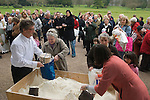 Tichborne Dole. Tichborne, near Arlesford, Hampshire. UK. Annually on Lady Day, March 25th 2007. Anthony and Catherine Loudon distributing dole flour.