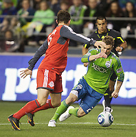 Seattle Sounders FC forward Mike Fucito  tries to get around Toronto FC defender Dan Gargan during play at Qwest Field in Seattle Saturday April 30, 2011. The Sounders won the game 3-0.