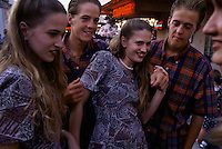 Triplet boys hang out with twin girls in Pomona, California at the Los Angeles County Fair. All competed in the twins/triplets competition.