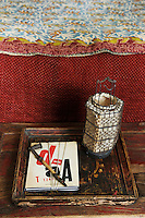 In this detail of the red bedroom an edition of Tristan Tzara sits on an antique bedside table
