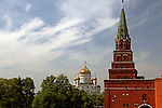 Europe, Russia, Moscow. Kremiln Tower with Cathedral of Christ the Savior in distance;