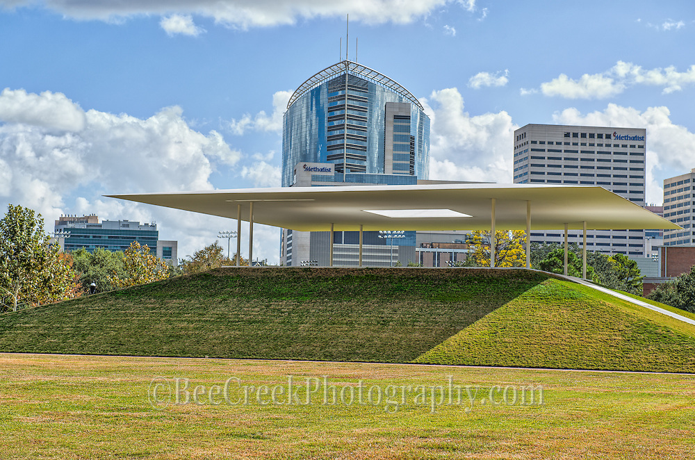 This is another image of the Centinnel Pavillion at Rice University with some of the high-rise buildings in the background from the Houston Medical Center like they Methodist Hospital with it unusual bow like shape.