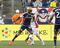 New England Revolution forward Dimitry Imbongo (92) dribbles. In a Major League Soccer (MLS) match, Toronto FC (white/red) defeated the New England Revolution (blue), 1-0, at Gillette Stadium on August 4, 2013.