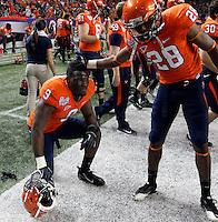 ATLANTA, GA - DECEMBER 31: Anthony Harris #28 comforts LaRoy Reynolds #9 of the Virginia Cavaliers during the 2011 Chick Fil-A Bowl against the Auburn Tigers at the Georgia Dome on December 31, 2011 in Atlanta, Georgia. Auburn defeated Virginia 43-24. (Photo by Andrew Shurtleff/Getty Images) *** Local Caption *** Anthony Harris;LaRoy Reynolds