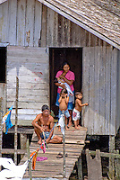 Family oustide their home on the bank of the Amazon River near Manaus, Brazil.