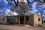 USA, New Mexico, Santa Fe. Humble building hosts an artisan shop in San Ildefonso Pueblo.