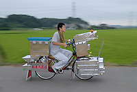 Mitsunari Fujita (14) rides his decochari customized bicycle along the side of a rice field. He spent 4 years working on the bike in his garage.