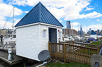 New York, United States. 19th May 2014 - A DirecTV antenna is seen at the Morris canal in Jersey City, New Jersey. Photo by Eduardo MunozAlvarez/VIEW
