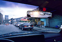 REARVIEW MIRROR (1 of 2)<br /> Day - Glaring Direct Reflection Off Silvered Back.<br /> Wedge shaped mirror in normal position is glaring at night.
