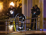 Commissioned by the Associated Press<br /> <br /> Tallahassee police investigate a shooting outside the Strozier library on the Florida State University campus in Tallahassee, FL. Nov 20, 2014.   The gunman was shot and killed by police officers. (AP Photo/Mark Wallheiser)
