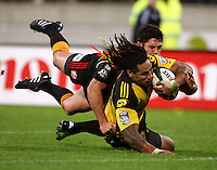 Ma'a Nonu beats Callum Bruce's tackle to give the Hurricanes the lead for the first time, with minutes left on the clock during the Super 14 rugby match between the Hurricanes and Chiefs at Westpac Stadium, Wellington, NewZealand on Saturday, 1 May 2010. Photo: Dave Lintott / lintottphoto.co.nz