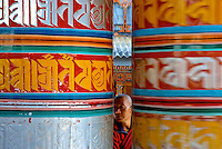Bhutan - monk and prayer wheels