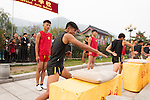 Students of Tagou Shaolin martial arts school conditioning their hands at the opening ceremony of Zhengzhou International Wushu Fetival in DengFeng, Henan, China 2014